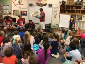Football Players Read to South Macon Students